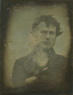 """Selfie no. 1 taken in 1839 by an amateur chemist and photography enthusiast from Philadelphia. Robert Cornelius had set his camera up at the back of the family store in Philadelphia. He took the image by removing the lens cap and then running into frame where he sat for a minute before covering up the lens again. On the back he wrote """"The first light Picture ever taken. 1839."""""""