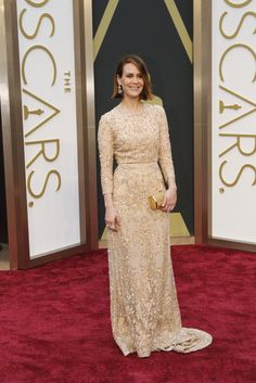 12a3fea6532 Sarah Paulson arrives in a stunning beaded Elie Saab nude gown with a  Ferragamo clutch and Piaget jewelry.