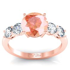 5 stone engagement ring with round brilliant morganite and sparkling white diamonds.