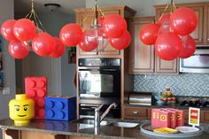 red balloons hanging from ceiling/ spell out Luke's name in Legos