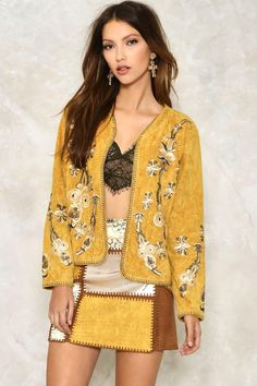 You've got nothing to hide. This jacket comes in mustard vegan suede and features an open front, relaxed silhouette, exposed stitching, and embroidery and sequin detailing throughout.