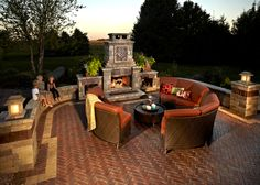 Love this backyard fire place and couch placement!
