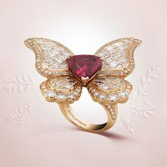 The Papillon rubis ring, adorned by a very rare 5.76-carat pear-shaped ruby, evokes the metamorphosis of Peau d'Âne back to her princely beauty. #VCApeaudane #HighJewelry Pink gold, round, square-cut and baguette-cut diamonds and one pear-shaped ruby of 5.76 carats (origin: Tanzania)