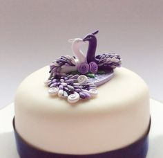 Peacock wedding cake topper in purple lilac and par fizzyclaret