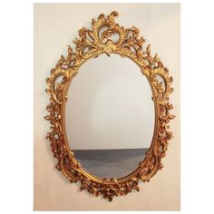 large gold mid century wall mirror - ornate oval framed mirror - Hollywood Regency by ninedoorsvintage on Etsy