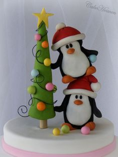'Tis the season to be jolly, so my little Penguin family are very busy decking the Christmas tree and affixing the Christmas lights! This is my second and final cake for Christmas this year. Although this theme is quite popular as I saw a. Christmas Topper, Polymer Clay Christmas, Cute Polymer Clay, Polymer Clay Projects, Polymer Clay Creations, Christmas Cards To Make, Christmas Gift Wrapping, Christmas Crafts, Christmas Ornaments
