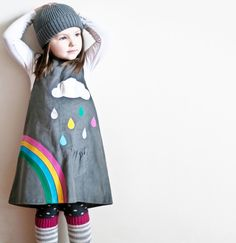 Little girls rainbow dress with silver cloud applique by Wild Things DressesBrighten up any grey autumn day with this beautiful cord rainbow & cloud applique pinafore.Silver cloud with pretty multi coloured raindrops falling into a little pocket.Rainbow