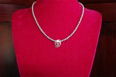 Hurricane Fleur De Lis necklace from TL Jewelry Designs