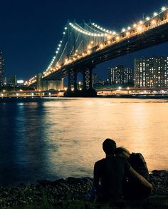 Sitting on the river bank... with a nice view of the bridge. Romantic.