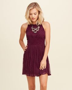Sweet and girly featuring mixed lace, a scoop back with tie detail and a high neck, Imported