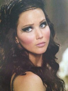 Katniss Everdeen. Too much makeup, representative of her war paint and readiness to fight and hiding her true self behind this persona.