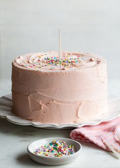 """My best tips (and recipe)for making velvety butter cake and whipped  vanilla frosting.  I've never been very good at setting New Years resolutions. Eat healthier,  get better sleep, try to exercise more – each year always looks the same.  Being a cake maker, it's hard to be on a """"diet"""" and even harder to fit in  sleep when you are a working mom of a 12-month old. Instead of a more  traditional resolution this year, I've decided to quit the excuses and just  try to be a little better all…"""
