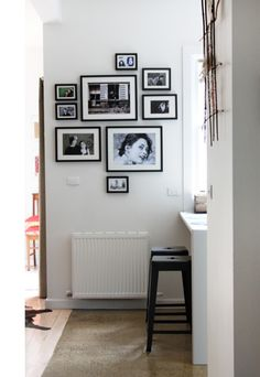 wall with black-and-white pictures