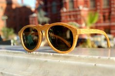 wooden sunglasses- Product Spotlight: The Retro Brown Bamboo. Handcrafted bamboo sunglasses in a classic retro style. The light weight frame is made from bamboo and the polarised lens reduces glare and protects the eyes. The brown bamboo colour for those who prefer the natural shade of wood.