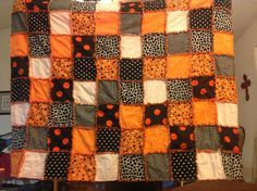 8x10 quilt-6 inch squares Giants colors (orange and black) Flannel in the middle (orange from Joanns) cheetah from Joanns big polka dots from , the rest from Wamart orange thread