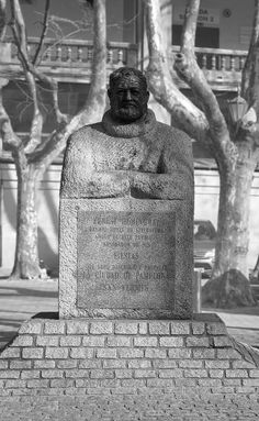 Pamplona City Hall,  Pamplona. Spain - Ernest Hemingway - Monument -- The sculpture consists of a large block of granite Guadarrama, whose lower part is configured as a pedestal, while the upper synthetically outlines the torso and arms of the writer and Nobel laureate for Literature American journalist Ernest Hemingway.