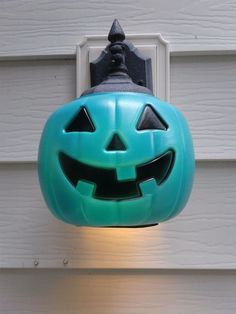 Cut a plastic pumpkin pail to fit over your porch light.  How easy is that?!