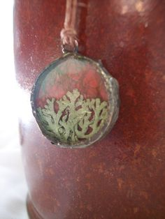 Round Lichen Moss Glass Solder Pendant Necklace 1 inch. $32.00, via Etsy.