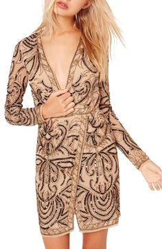 Sparkling beads and shimmering sequins arranged in scrolling patterns amp the glamorous vibes of this wrap-effect dress cut with a plunging neckline and layered hemline.