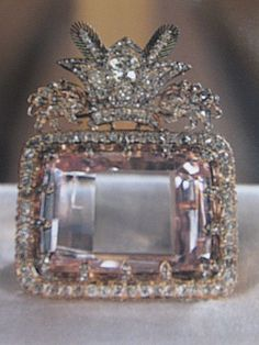 Uhhh. Wow.....Considered to be the most celebrated diamond in the Iranian Crown Jewels and one of the oldest known to man, the 186-carat Darya-i-Nur is a crudely fashioned stone measuring 41.40 × 29.50 × 12.15 mm. The name means Sea of Light, River of Light, or Ocean of Light. It is a table or 'taviz' cut diamond.