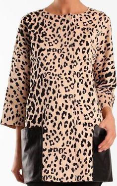 Olivia Palermo wearing Tibi Cheetah Coat.