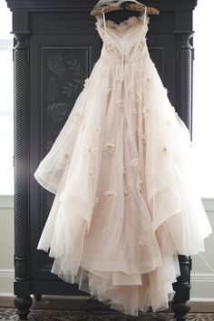 Beautiful wedding dress with flowers and sheer material.