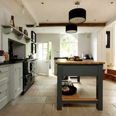 Pale-Blue-and-Stone-Floor-Country-Kitchen