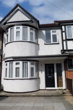 Bay and casement UPVC windows, the white of the frames offset beautifully by the black cills and fascias. 1930s House Exterior, Casement Windows, Bay Windows, Home Projects, House Design, Mansions, House Styles, Beautiful, Frames