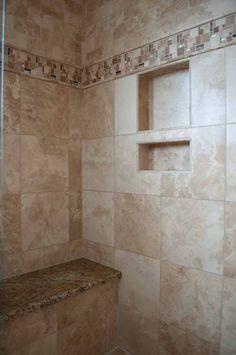 Briargate bathroom remodel, Colorado Springs, travertine shower tile, Moen Brantford plumbing fixtures, St. Cecilia granite bench, built-in cubby