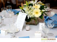 Wedding reception table settings, decor and flower centerpiece. Blue, yellow, white and green themed. www.kevintrimmer.com