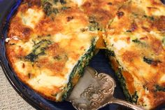 Crustless Sweet Potato and Goat Cheese Quiche Recipe Main Dishes with eggs, milk, frozen spinach, sweet potatoes, olive oil, garlic cloves, hot red pepper flakes, goat cheese, shredded cheddar cheese, salt, pepper