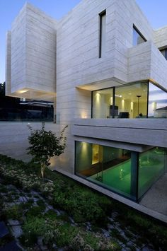 Gorgeous geometric house and glass walls.