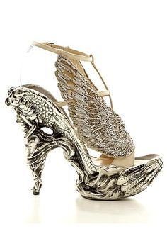 Alexander McQueen. These are the kind of shoes you wear with nothing else! - never seen anything this beautiful.