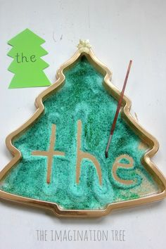 Create a Christmas tree sensory writing tray to encourage mark making, early letter formation and sight word learning!