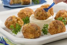 When you're craving the cheesy-fried goodness of a popper, but want something a little different from the average jalapeno popper, make these Cheesy Crab Poppers. They're crispy, cheesy, and have just a light kick to 'em, making them the perfect part