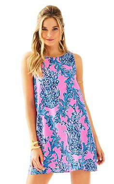 JACKIE SHIFT DRESS The cut in armholes on the Jackie Shift are what set this printed dress apart. Add some gold accessories to dress up this shift.