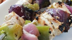 greek Chicken Kebabs: chicken pieces are marinated in a blend of yogurt , lemon juice, and feta, then grilled on skewers with onions and green peppers.