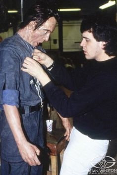 """Tom Woodruff, Jr. dresses the """"ripped in half"""" Bishop puppet during production of ALIENS."""
