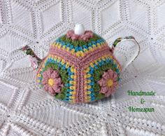 Floral Granny Square Tea Pot Cozy from https://www.facebook.com/HandmadeandHomespun