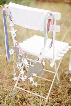 Chair Decor   #Star Motif   On #SMP Weddings: http://www.StyleMePretty.com/2014/01/06/le-grand-banc-provence-wedding/   Xavier Navarro Photography