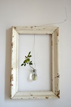 - empty frame with suspended lightbulbvase plus leaves - Orietta Marcon of Vicenze-based design studio Civico Quattro in a loft in italy. inspired living room A Rustic Loft in Italy, from a Rising Design Star - Remodelista Cuadros Diy, Empty Frames, Empty Wall, Empty Picture Frames, Old Frames, Diy Décoration, Diy Home Decor, Gallery Wall, Gallery Frames