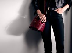 A red bucket bag is the season's byword for glamour on-the-go. #StyleTip