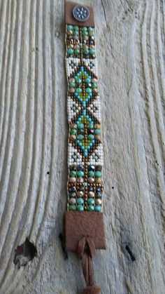 Southwest boho chic Native American influence hand-woven Japanese seed beads Czech glass this beautiful bracelet measures 1 inches wide and fits a size 6 to 8 inch wrist it closes with a handmade sterling silver button