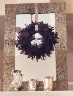 Purple peacock wreath on Pier One tiled mirror.    Mercury glass hurricanes from Z Gallerie.  Super Glam!