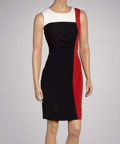 Who says a sophisticated look need blend in with the crowd? With its color block panels and gathered pleats, this dress promises to stand out in style.