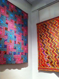 woven ribbons and streaks of lightning quilts by Kaffe Fassett at the Welsh Quilt Centre.  Photo by Claire Leggett