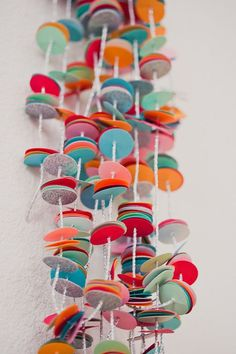 DIY Confetti Garland by subtlerevelry: Made with a Martha Stewart Circle Paper Punch, 12 sheets of multi colored card stock, a silver cord, and a large eye sharp needle. #DIY #Confetti