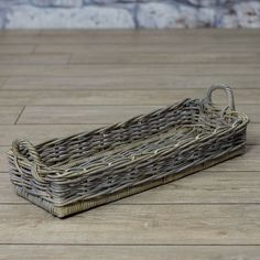 Basket with rattan handle in cubu in antique grey finish.