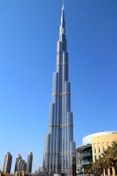 The world's tallest building overlooks the city of Dubai and is a shiny beacon just calling the kids to come take a look. To find out other Dubai city  highlights, check out http://www.suitcasesandstrollers.com/interviews/view/dubai-with-kids-dubai-insider?l=all #travel #travelwithkids #familytravel #familyholidays #familyvacations #traveltips #Dubai
