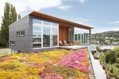 Ballard Cut Residence by Prentiss Architects That flowery area is the roof of the lower floor of the building!